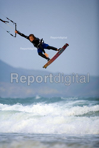 A kitesurfer performing jumps, at Parr Sands in Cornwall. - Paul Box - 2006-10-16