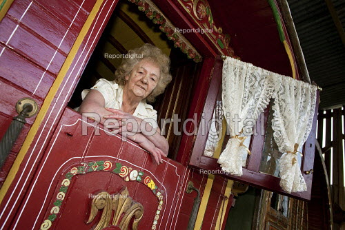 Maggie Smith-Bendell is a Romani Gypsy standing inside her traditional gyspy caravan, although 69 years old is still campaigning for better conditions for travellers. She is a writer and has recently published Our Forgotten Years A Gypsy Womans Life on the Road. - David Mansell - 2010-02-06