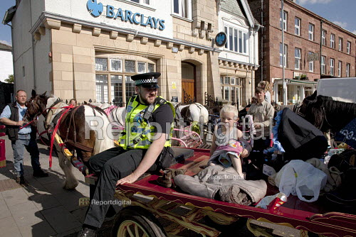 Appleby Horse Fair, Cumbria. Police take a lesson in parking a horse in Kirkby Stephen. - David Mansell - 2015-06-04