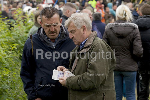 Appleby Horse Fair, Cumbria, Chris Booth on left completing a horse sale - David Mansell - 2015-06-06