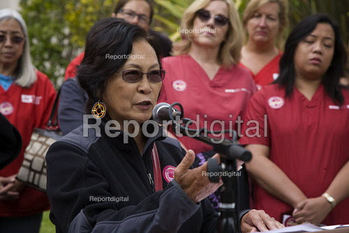 Lillian Galedo, director of Filipino Advocates for Justice, speaking. California Nurses Association and supporters protest strike at discrimination against Filipino nurses at Herrick Alta Bates Hospital by its owner Summit Hospitals. They accuse Summit of moving to close the hospital, and denying new work to nurses from the Philippines - David Bacon - 2012-08-23