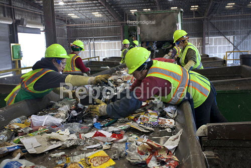 California- Workers sort and process paper, cardboard, plastic, and glass from waste collected in local cities. Alameda County Industries - David Bacon - 2015-02-18