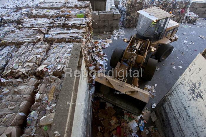 California- Workers move trash using a skip loader. Recycling and sorting facility Alameda County Industries - David Bacon - 2015-02-18