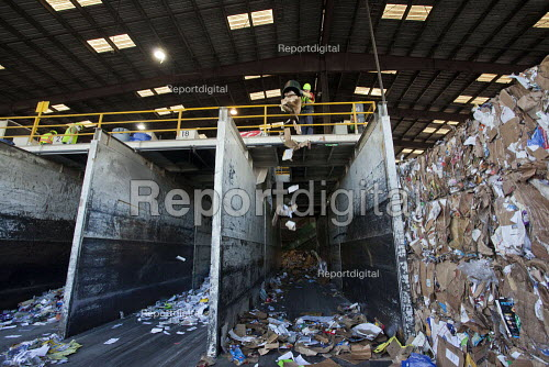 California- Workers at the recycling sorting facility of Alameda County Industries sort and process paper and cardboard from trash collected in local cities. - David Bacon - 2015-02-18