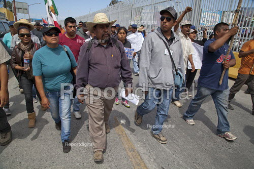 Tijuana, Mexico, Farmworkers in AONEMJS on strike for better conditions and pay. From the San Quintin Valley in Baja California migrant workers march to the USA Mexico border to draw attention to the fact that the fruit they pick are exported to the USA AONEMJS is a new union. The workers are indigenous Mixtec and Triqui migrants from Oaxaca, in southern Mexico. - David Bacon - 2015-03-29
