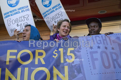 USA, SEIU Pres Mary Kay Henry in a protest at a McDonalds fast food restaurant, workers calling for 15 an hour minimum wage and union rights in a global day of action. Asian American and Pacific Islander (AAPI) Mission District, San Francisco, USA - David Bacon - 2015-04-15