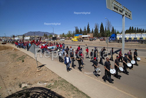 Cananea, Sonora, Mexico, The drum and bugle corps of Striking miners march at the Cananea copper mine occupying a pumping station, which has shut down mine operations. They are joined by residents and farmers of towns on the Sonora River, who were devastated by a release of 40,000 cubic meters of acid and heavy metal waste in August 2004. They are demanding the government intervene to force the mine owner, Grupo Mexico, to clean up the river and return the striking miners to their jobs. - David Bacon - 2015-03-26