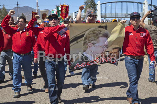 Cananea, Sonora, Mexico, Striking miners march at the Cananea copper mine occupying a pumping station, which has shut down mine operations. They are joined by residents and farmers of towns on the Sonora River, who were devastated by a release of 40,000 cubic meters of acid and heavy metal waste in August 2004. They are demanding the government intervene to force the mine owner, Grupo Mexico, to clean up the river and return the striking miners to their jobs. - David Bacon - 2015-03-26