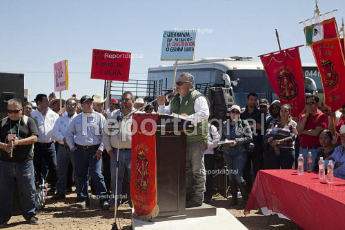 Cananea, Sonora, Mexico, Sergio Tolano head of Section 65 of the miners union, Los Mineros speaking at a rally. Striking miners march at the Cananea copper mine occupying a pumping station, which has shut down mine operations. They are joined by residents and farmers of towns on the Sonora River, who were devastated by a release of 40,000 cubic meters of acid and heavy metal waste in August 2004. They are demanding the government intervene to force the mine owner, Grupo Mexico, to clean up the river and return the striking miners to their jobs. - David Bacon - 2015-03-26