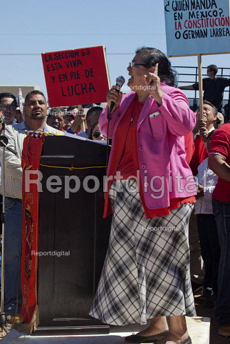 Cananea, Sonora, Mexico, Martha Patricia Velarde Ortega, leader of the local community resisting the contamination of the river, speaking at a rally. Striking miners march at the Cananea copper mine occupying a pumping station, which has shut down mine operations. They are joined by residents and farmers of towns on the Sonora River, who were devastated by a release of 40,000 cubic meters of acid and heavy metal waste in August 2004. They are demanding the government intervene to force the mine owner, Grupo Mexico, to clean up the river and return the striking miners to their jobs. - David Bacon - 2015-03-26