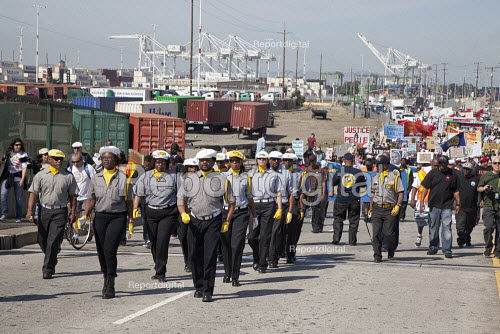 California Dockworkers ILWU drill team and supporters rally and march in the Port of Oakland on May Day, to protest at the killing of young black men by police across the country. - David Bacon - 2015-05-01