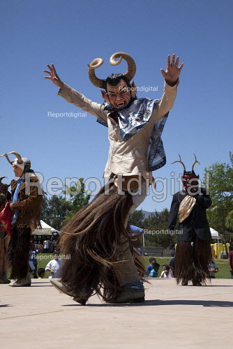 California, Danza de los Diablos, or the Dance of the Devils. Dancers from the Triquis of Oaxaca, now living as migrants in the USA, at a festival of Oaxacan indigenous culture in Greenfield, where many Triquis have settled. - David Bacon - 2015-04-19