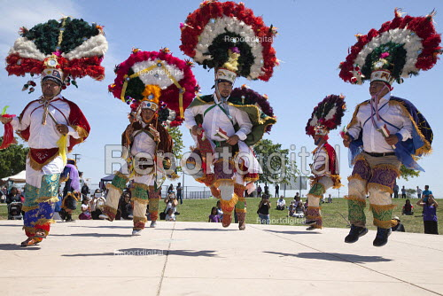 California, Dancers from the Triquis of Oaxaca, now living as migrants in the USA, at a festival of Oaxacan indigenous culture in Greenfield, where many Triquis have settled. Dancers perform the Danza de la Pluma or the Dance of the Feathers. - David Bacon - 2015-04-19