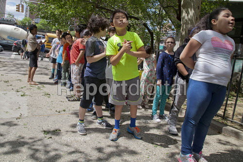 Pupils during a fire drill wait on the sidewalk, New York City street, USA - David Bacon - 2015-05-12