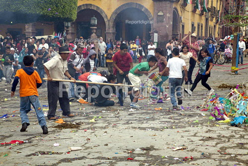 Mexico, Fiesta for St. Michael, the patron saint of San Miguel de Allende. Paper mache dolls of devils, ballerinas and other figures, and fillied with candy, they are then exploded on the main plaza, while children rush to grab the sweets. - David Bacon - 2014-10-03