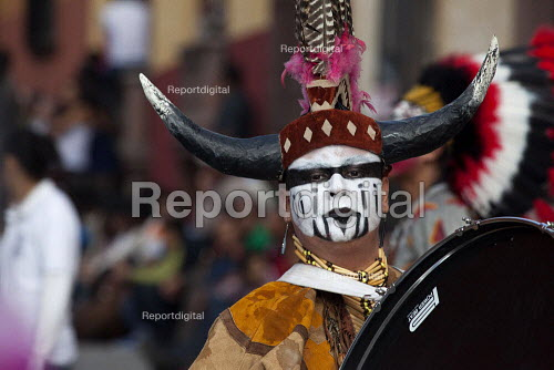 Mexico, Fiesta for St. Michael, the patron saint of San Miguel de Allende. Groups of dancers from all over Mexico parade through the streets. Many are performing dances of indigenous people. - David Bacon - 2014-10-03