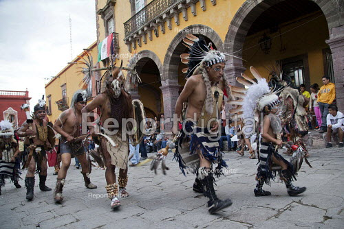 Mexico, Fiesta for St. Michael, the patron saint of San Miguel de Allende. Groups of dancers from all over Mexico parade through the streets performing dances of indigenous people. - David Bacon - 2014-10-03