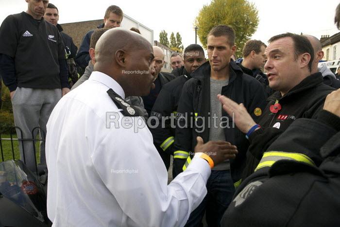 London fire strike, Picket Tottenham Fire Station. Working Firefighter Daniel Alie a Station manager Hornsey Fire Station, talks to stiking firefighters - Duncan Phillips - 2010-11-01