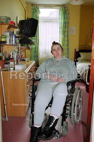 Disabled resident in her room at a Council run Care Home - Duncan Phillips - 2002-01-18