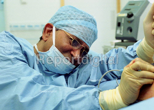 Surgeon inserting a Breast implant - Duncan Phillips - 2001-01-23