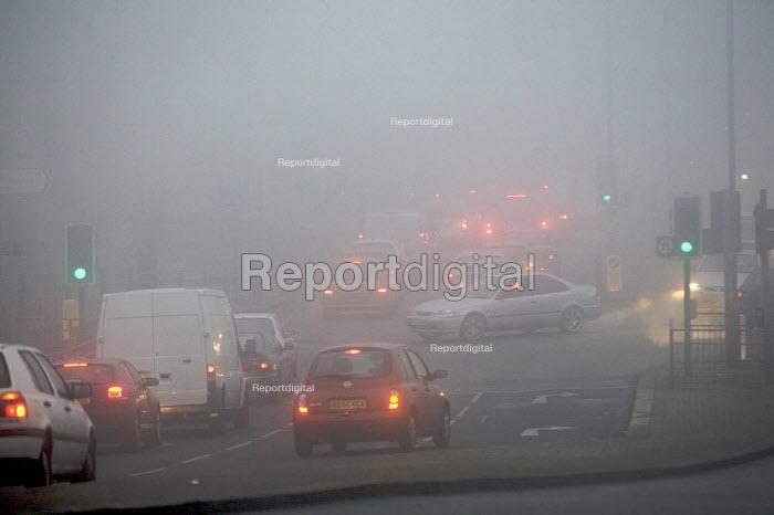 Traffic driving in heavy Fog, London. - Duncan Phillips - 2006-12-22