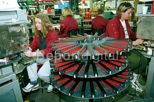 Factory workers producing model railway carriages - Duncan Phillips - 2001-10-23