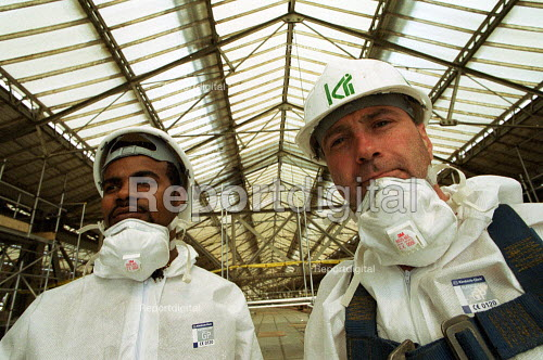 Construction workers in protective clothing carry out work on Waterloo Railway Station roof - Duncan Phillips - 2001-11-20