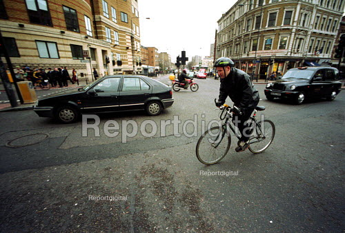 Cyclist Commuting to work, Central London - Duncan Phillips - 2002-02-06