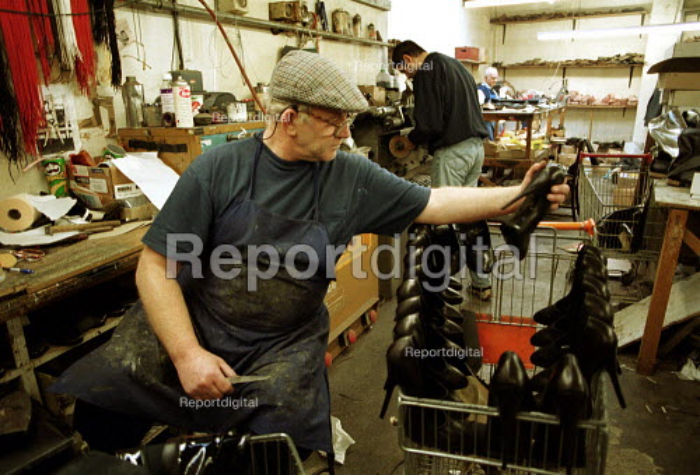 Cobbler checking leather stiletto shoes. - Duncan Phillips - 2002-01-31