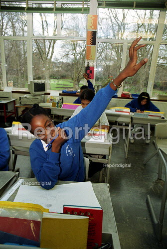 Pupil with her hand up, lesson at a C of E primary School, Islington North London - Duncan Phillips - 2002-02-05