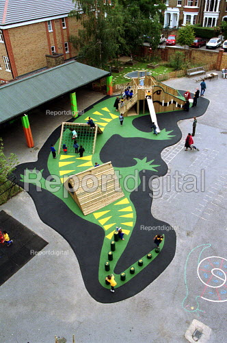 School Children play on a new crocodile playground which has been built to replace the hard concrete one at a North London Primary School. - Duncan Phillips - 2002-01-30