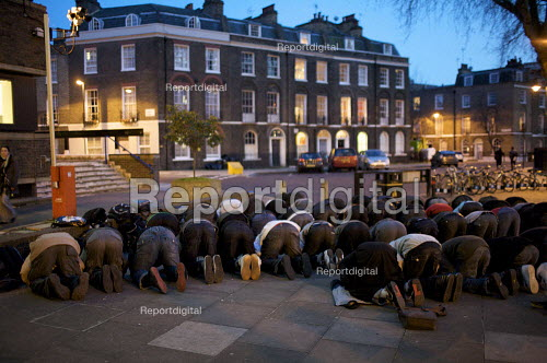 Call to evening Prayer. Muslim students at city university, London take part in evening prayers outside the university. Northampton Square, London - Duncan Phillips - 2010-03-02