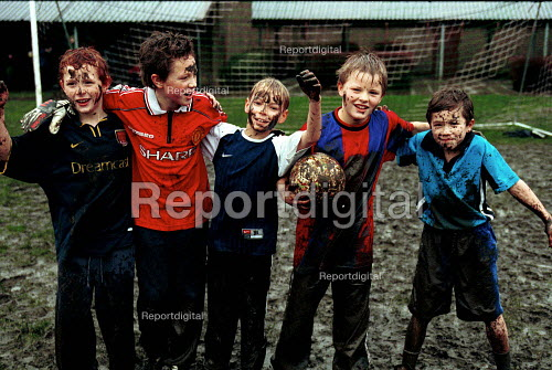 Muddy kids football kick about, Islington, London - Duncan Phillips - 2000-12-15