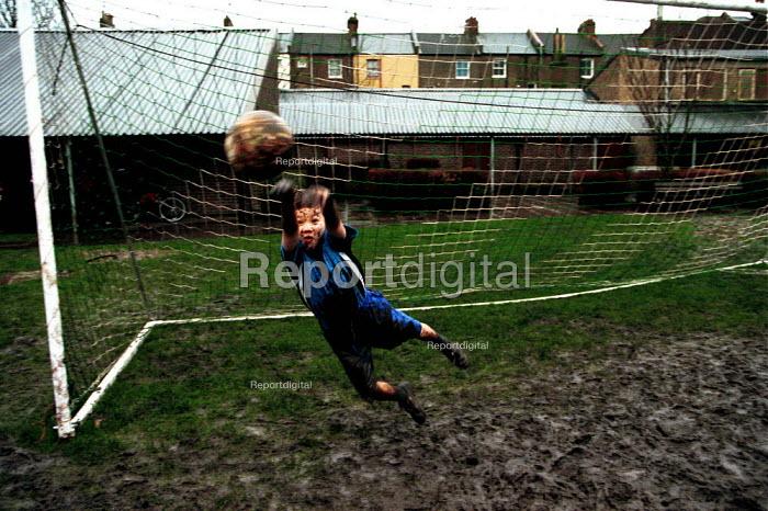 Muddy kids football kick about, Islington, London - Duncan Phillips - 2000-12-15