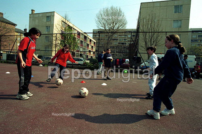 Girls practicing ball skills on a football training session Kings Cross London - Duncan Phillips - 2000-05-15
