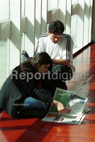 Students checking University places in a newspaper after receiving their A level results - Duncan Phillips - 2002-10-24