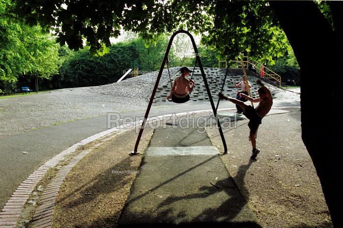 Children on swings islington London - Duncan Phillips - 2002-07-12
