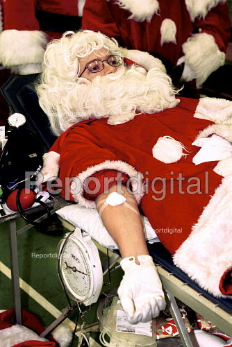 Santa giving Blood as part of a campaign to prevent a shortage over the christmas holiday. - Duncan Phillips - 1999-12-15