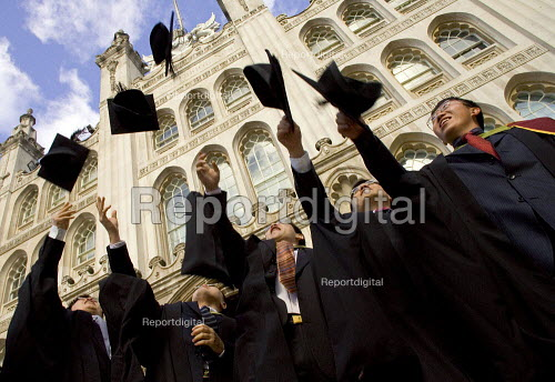 University graduation celebration, Guildhall, London. Throwing mortarboards into the air - Duncan Phillips - 2006-03-01