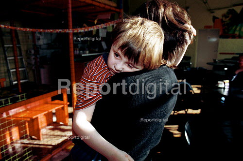 Autistic child with mother at an indoor play centre - Duncan Phillips - 1999-04-05
