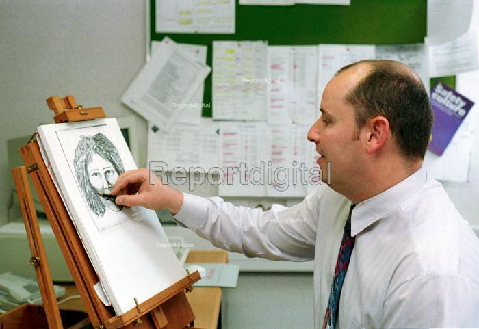 British Transport Police Artist sketching a suspect. - Duncan Phillips - 1999-10-18