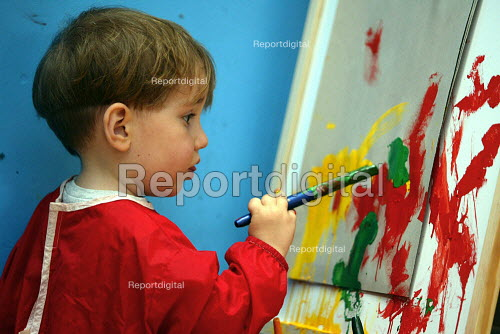 Child painting at a nursery school - Duncan Phillips - 2003-08-15