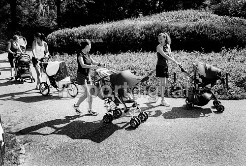 Mothers with pushchairs exercising in Central Park. New York City, USA - Duncan Phillips - 2002-08-13