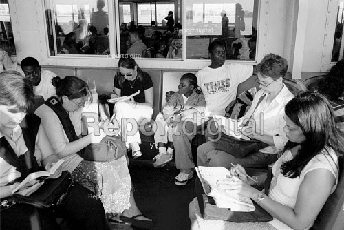 Passengers reading on the Staten Island Ferry with New york City in the Background.USA - Duncan Phillips - 2002-08-13