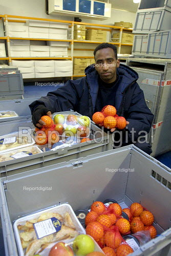 Train Catering department Euston Station. Worker in the refridgerated area with a selection of fresh produce - Duncan Phillips - 2003-03-18
