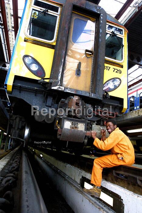 Apprentices involved in mechanical maintenance of trains. Hornsey Depot LMD, London. - Duncan Phillips - 2003-03-24