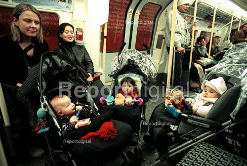 Mothers with children on a London Underground train. - Duncan Phillips - 2003-01-15