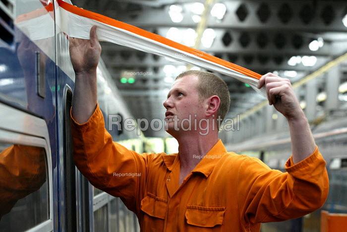 Bodyshop engineer working on refurbishing a train carriage - Duncan Phillips - 2004-10-09