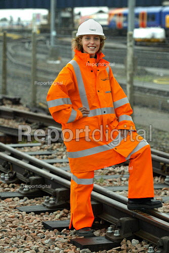 A young woman Network Rail worker in High visibility safety clothes - Duncan Phillips - 2004-10-09
