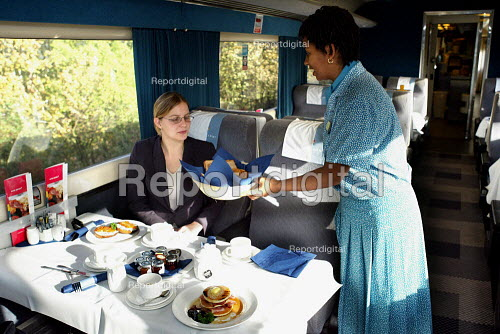 Steward serving breakfast on the ONE train service from Norwich to London - Duncan Phillips - 2004-10-25